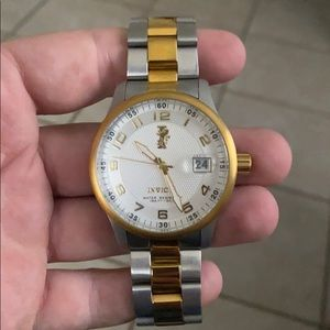 Gold and silver Invicta watch
